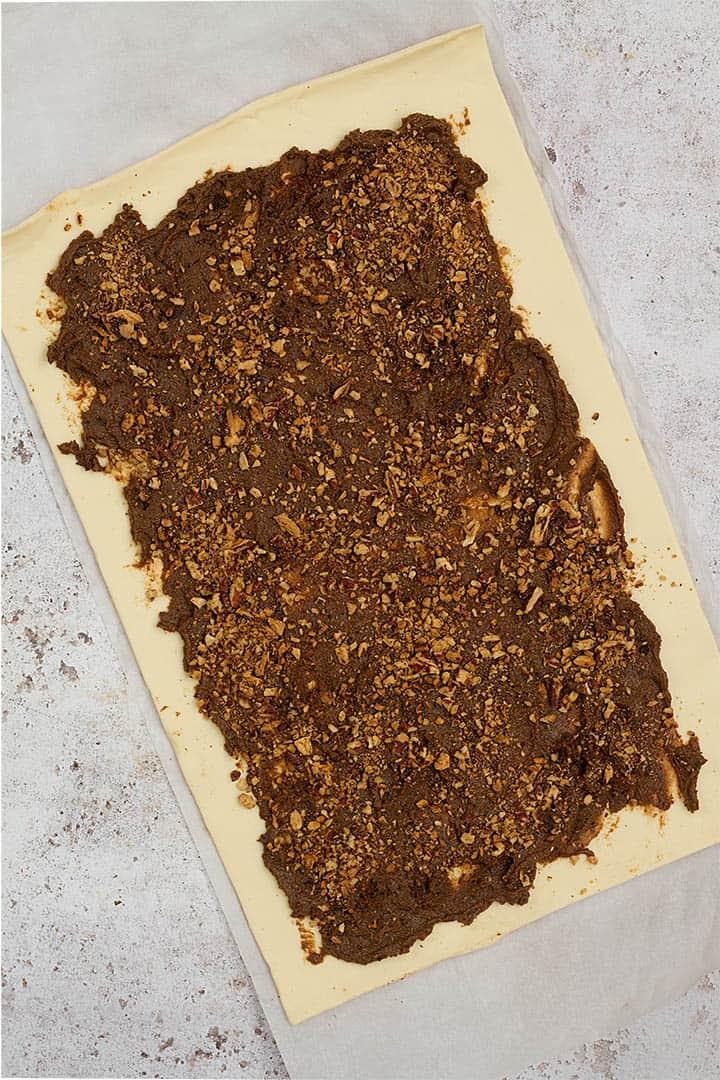 making puff pastry cinnamon rolls