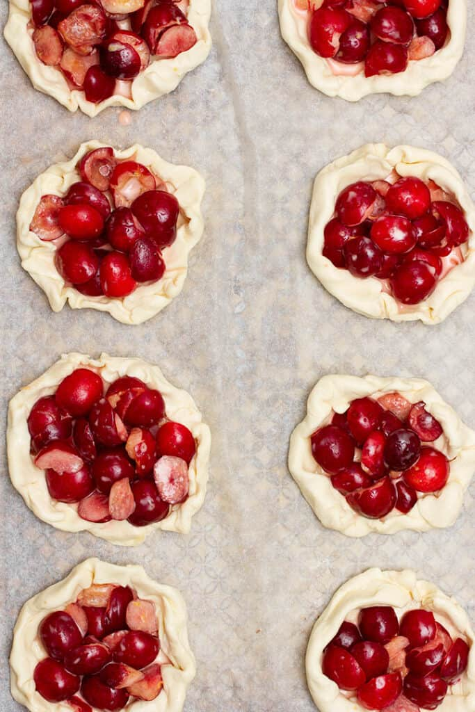 mini cherry tarts on baking tray