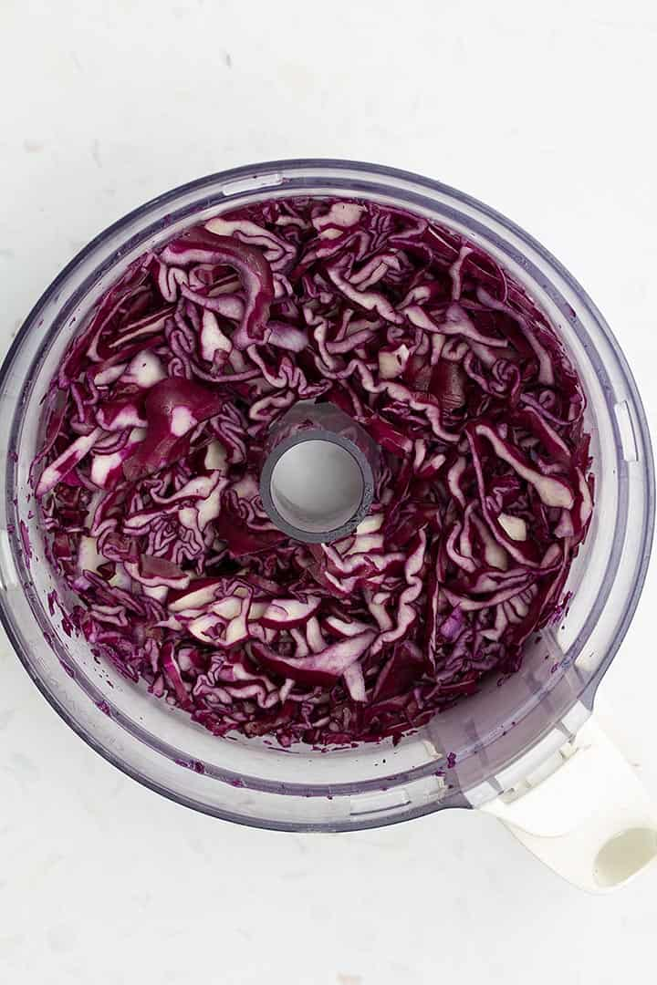 coleslaw being chopped in processor