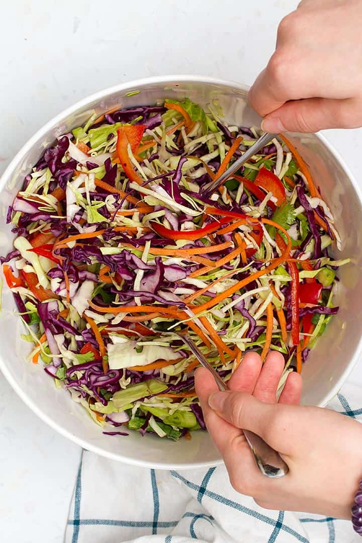 mixing asian coleslaw