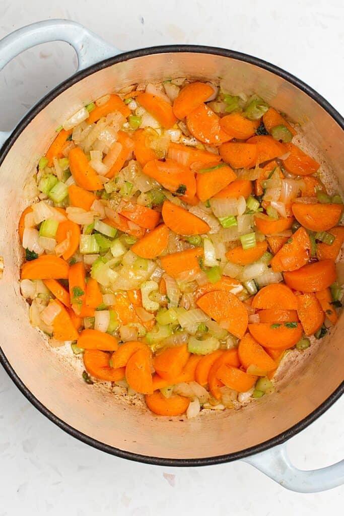 onions, carrots, celery in pan