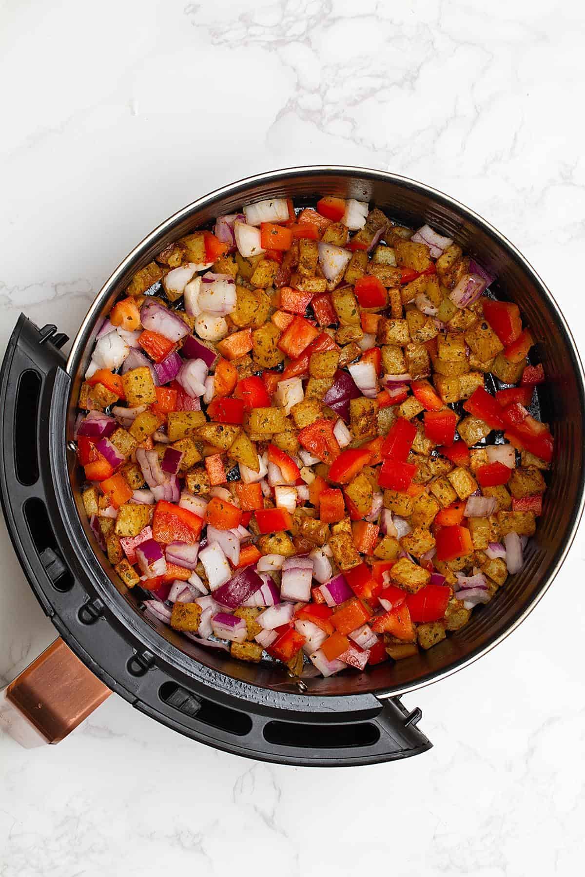 diced potatoes, red peppers and onions in air fryer