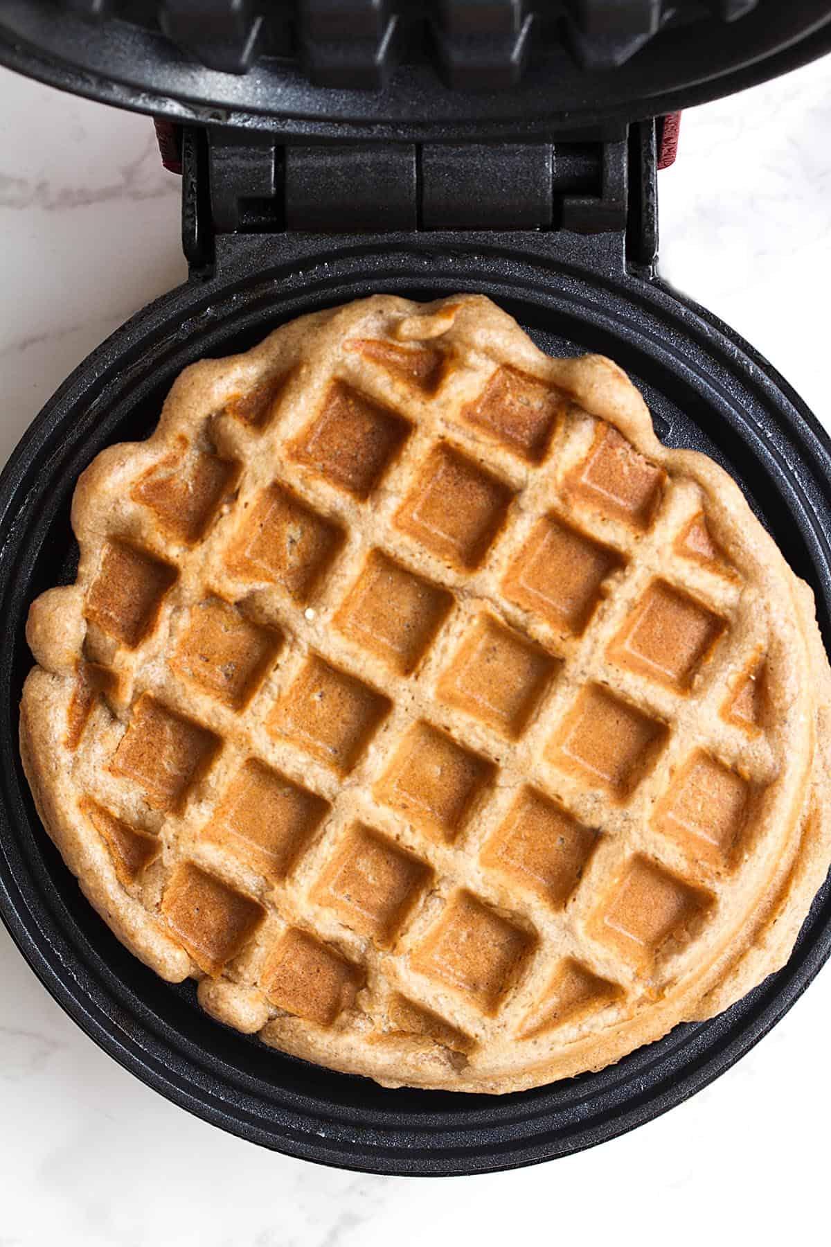 banana oat waffles in waffle iron